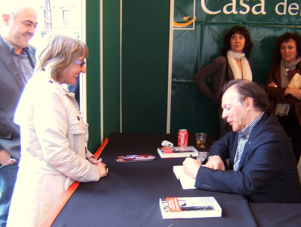 Spanish novelist Javier Marias signing a book.